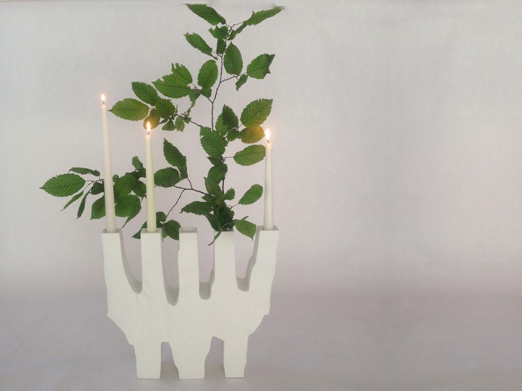 flower and candles together in a candlestick