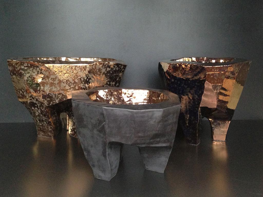 Three bronzed ceramic centerpieces